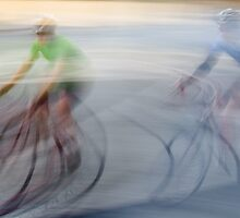 Cyclists, blurry by Nic MacBean