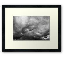 Flying through the storm Framed Print