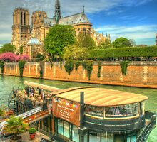 Notre Dame with restaurant on the Seine by Michael Matthews