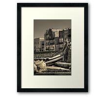 Boats on shore Framed Print