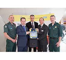 London Ambulance Service show the public  how to use a Defibrillator Photographic Print