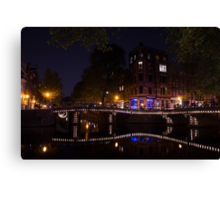 Magical, Sparkling Amsterdam Canals and Bridges at Night Canvas Print