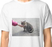 Female hand closeup petting stray cat Classic T-Shirt