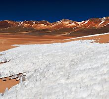 ice and snow structures in front of The Mountain of Seven Colors by travel4pictures