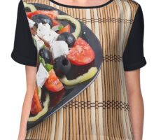 Fresh vegetarian salad in a black plate on a bamboo mat closeup Chiffon Top