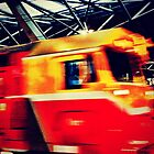 red and yellow train, melbourne 5336 by MAGDALENE CANTO
