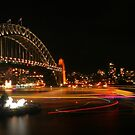 Colourful boat trails on Sydney Harbour by Michael Matthews