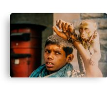 Intellectually disabled boy and his monkey, India Canvas Print