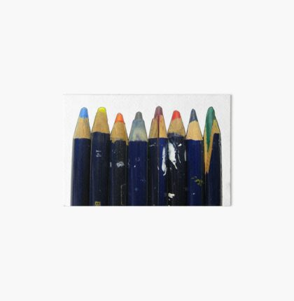 Old colored art pencils in a row, drawing, artist materials Art Board