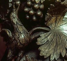 Bird eating grapes St Mary's church Madley England 198405170081  by Fred Mitchell
