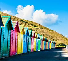 Colorful beach huts by Stanciuc