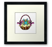 easter bunny sitting in a basket with Easter eggs Framed Print
