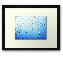 drops on a transparent surface with a blue to white gradient background Framed Print