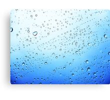 drops on a transparent surface with a blue to white gradient background Canvas Print