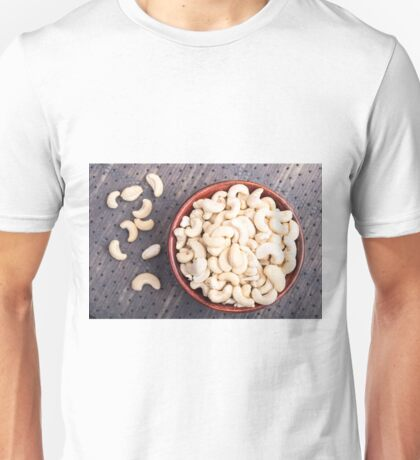 Raw cashew nuts in a brown bowl on fabric background Unisex T-Shirt