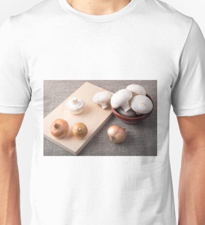 Raw champignon mushrooms and onions on the tabletop Unisex T-Shirt