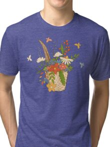 Basket with a bright bouquet of flowers. Tri-blend T-Shirt
