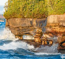 Sea Caves Pounded by Superior Waves by Kenneth Keifer