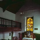 Nave and altar with stained glass window behind Small church Capel y Ffin Wales 198405170104 by Fred Mitchell