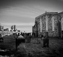 Whitby Abbey and cemetery during the night in North Yorkshire,UK. by Stanciuc