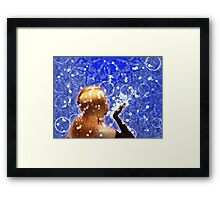 Blond girl is blowing snowflakes Framed Print