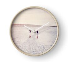 Surfers in the snow. Clock
