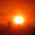 Hazy Sunset over New York City  by Alberto  DeJesus