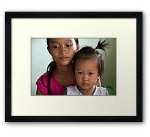 Trust your big sister... Framed Print