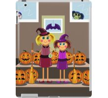 little girls in suits of the witch among pumpkins celebrate a Halloween iPad Case/Skin