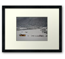 Barn on a snow covered German hillside Framed Print