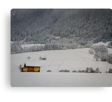 Barn on a snow covered German hillside Canvas Print