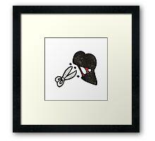 cutting black heart cartoon Framed Print