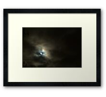 The moon on a cloudy night. Framed Print
