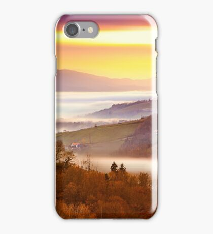 Blurred sunset over a sea of fog iPhone Case/Skin
