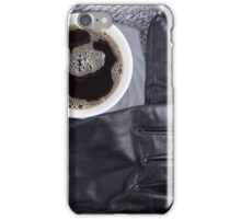 Top view of a white cup of coffee and black women's gloves iPhone Case/Skin
