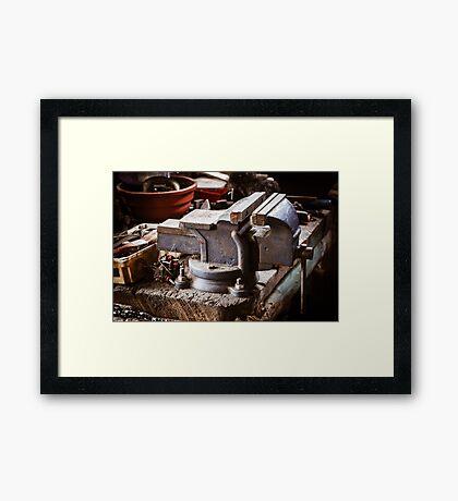 Vintage vise on the wooden table Framed Print