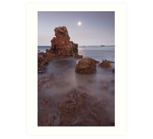 Moon rise over rock outcrop.  Art Print