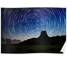 Star trails over Devils Tower Poster