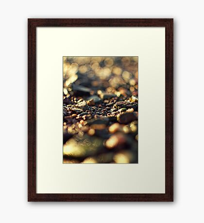 abstract bokeh sunlit stones Framed Print