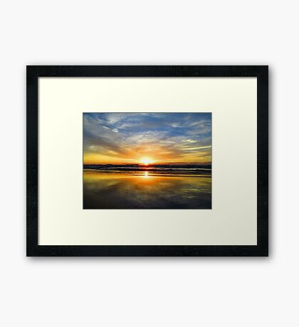 Dramatic orange and yellow sunset  Framed Print