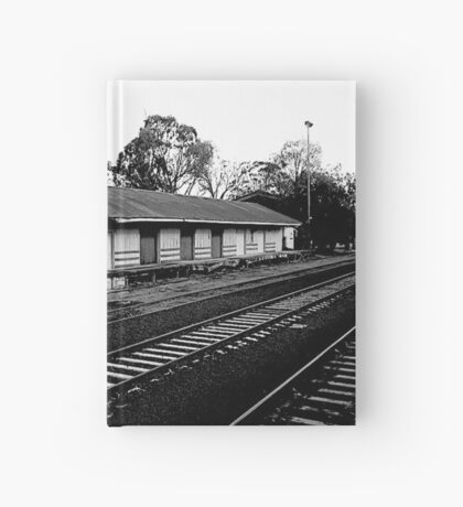 A dis-used train platform Hardcover Journal