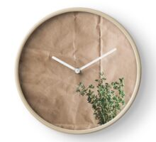 The plant on the background of kraft paper Clock