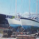 Two yachts receiving maintenance in a yard by martyee
