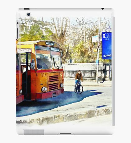Buses and child riding a bicycle in Aleppo iPad Case/Skin