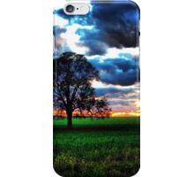 Tree against a rolling sunset iPhone Case/Skin
