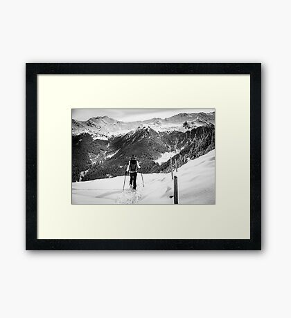 girl trekking with snowshoes in the wood Framed Print