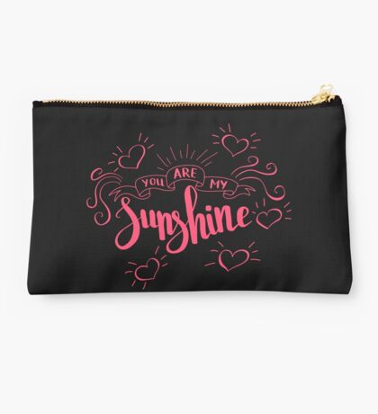 You are my sunshine. Love quote for Valentine`s day. Black background. Studio Pouch