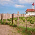 Lifeguard Hut Seen through Fence by Gerda Grice