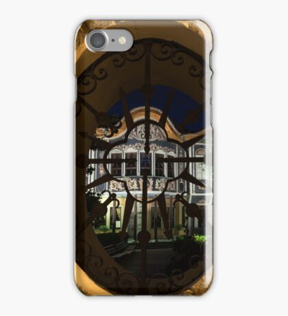 Illuminated Night View - Magnificent Revival House Through a Fence Window iPhone Case/Skin