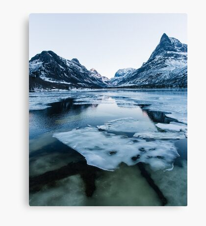 Ice Floating on Innerdalen Lake With Mountain Range on Freezing Winter Day Canvas Print